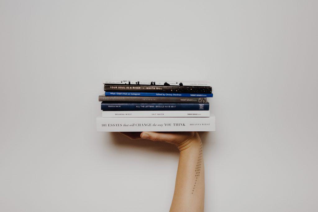 hand holding books